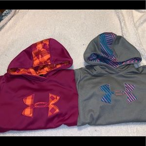 Two girls under armour hoodies